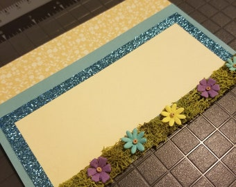 Blank greeting card with reindeer moss and paper flowers