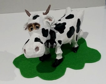 Bessy the cow character carving