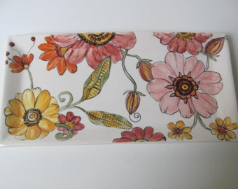 Rectangular plate with flowers painted