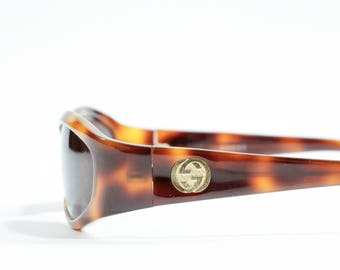 GUCCI - Plastic maculate sunglasses oval model