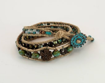 Triple leather wrap, Picasso beads with antiqued bronze button closure and wooden flower focal.