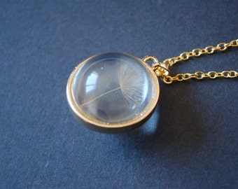 Gold tone dandelion dome necklace