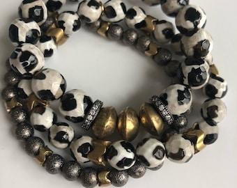 Mixed metal stack bracelets