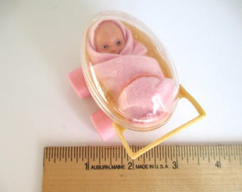 Small Baby in Carriage Plastic
