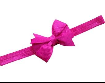 Fucshia 3 inch pinwheel style bow on matching elastic headband