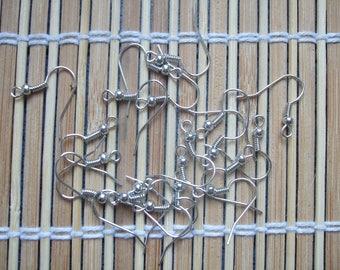 Twenty silver-tone hook earrings