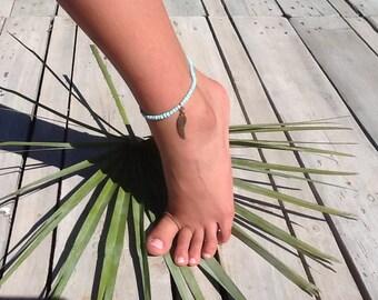 Anklet, ankle bracelet, blue sky.