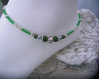 Green ankle bracelet.