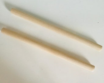 Set of 2 light wood sticks