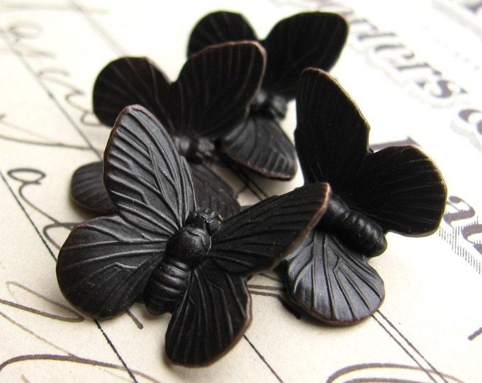 Black butterfly ornaments, 18mm wing span, dark antiqued, 4 butterflies, aged black patina, garden bug insect flight, Fallen Angel Brass