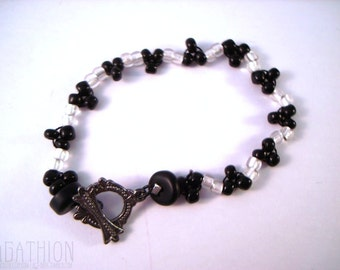 Black and White Tri-Stitch Triangles Beaded Bracelet with gunmetal toggle clasp and seed beads