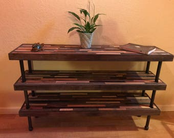 Unique reclaimed, industrial modern bookcase with pipe supports