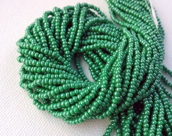 FULL HANK - 12 stands - 11/0 Opaque green luster Czech glass seed beads - about 36 grams (approx. 4000 beads)