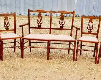 A stylish and sophisticated late 19C 8 piece parlour suite comprising 1 sofa chair, 2 carvers and 4 individual chairs