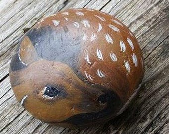 Hand painted baby deer on a beach rock.