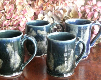 Set of four wheel thrown stoneware mugs