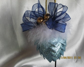 Handcrafted christmas ornaments ribbon pinecone ornament trimmed with blue wired ribbon and feather and beads