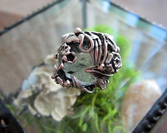 Gorgeous floral ring with faceted rutilated quartz. Adjustable size. Antique Silver Plated Brass.