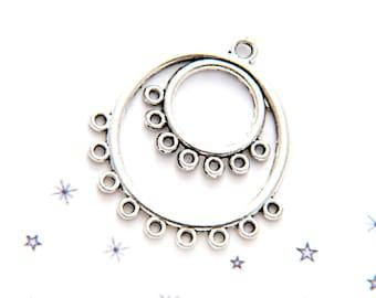 spacer between two silver coloured metal chandelierrond