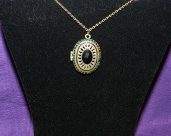 Large Antique Locket with a crystal in the center with a magnet closure.