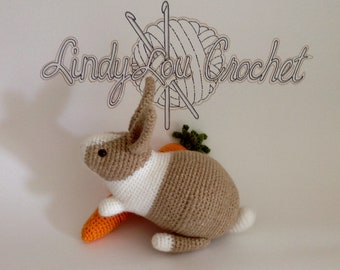 Hand-crocheted Nibbles the baby rabbit soft toy crochet with carrot.