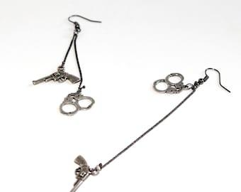 Chains, handcuffs and gun earrings