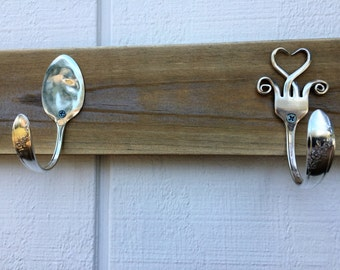 Bent Fork and Spoon Coat Hanger. Made with 1946 Queen Bess pattern, Silver Plate