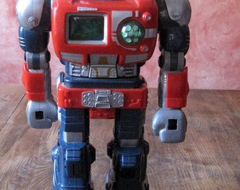 Former interactive toy robot works has batteries, Gift Idea.  boat. Cadeaux.old toys