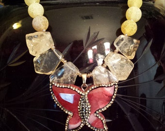 One strand beaded matte yellow jasper necklace with rose butterfly drop
