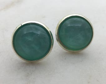 Shell turquoise glass dome stud earrings. 14mm with surgical steel and nickel free posts.