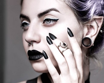 Occult midi ring in Old Steel - A midi ring with the Sun and Moon hiding from each other. A Black Lip Pearl gem captures the last light.