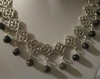 Celtic collar style necklace with smokey quartz