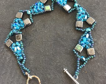 Beaded turquoise and gray Czech tile bracelet with superduos