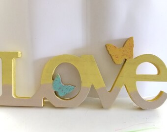 Yellow and Tan Painted Love Sign