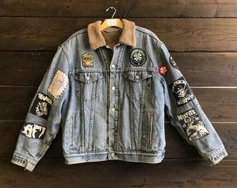 Vintage 90s Patched/Embroidered Levis Sherpa Denim Trucker Jacket