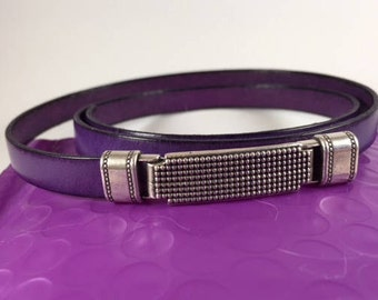 Quality plum leather and eye-catching antique silver center/closure.