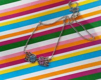 Luna Lovegood Quibbler inspired glasses necklace.