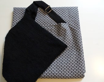 black and white apron with removable towel