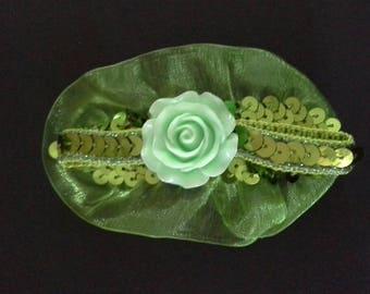 1 green flowered clip