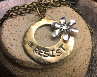 hand stamped brass necklace RESIST