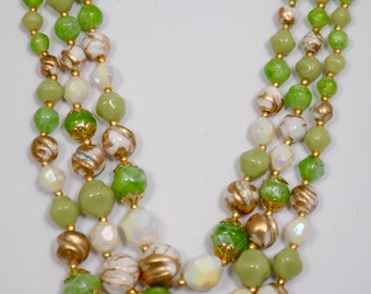 Vintage Necklace adjustable with three strands of different size beads marked Hong Kong, early 1950's