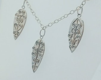 Sterling silver necklace with intricate wirework detail