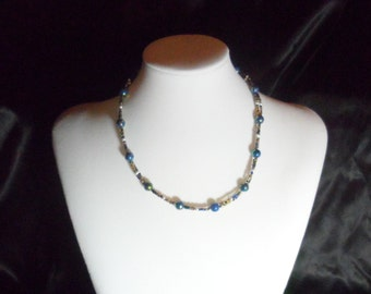 Blue, White, and Gold Colored Bead Neckace.
