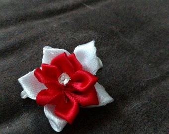Red and white flower clip