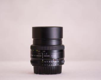 Nikon 50mm F 1.8 D -  F Mount Lens for DSLR cameras. Nikon AF NIKKOR 1:1.8  - Used - Condition 8.5 of 10 - with metal lens hood.