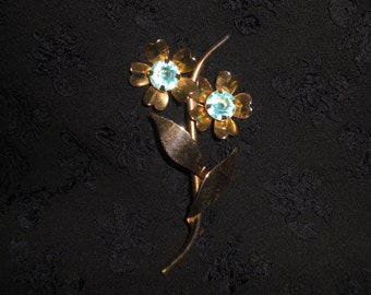 Vintage 1950s  to  1960s Faux Glass Rhinestones Aqua Two Flower Gold Tone Leaves Long Brooch Pin