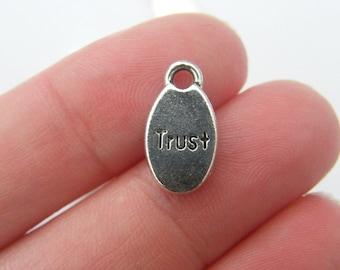 10 TRUST charms antique silver tone M302