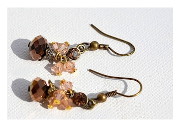 "The simplicity of these earrings ""romantic hippie chic"" bronze with its bronze, pale pink powder tint crystals."