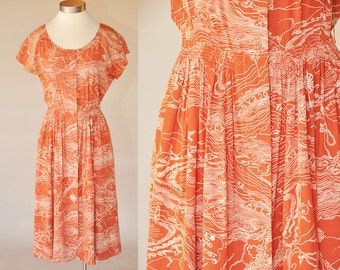 vintage 40s orange cold rayon dress | short sleeves, cinched waist | topographic map print XS/S