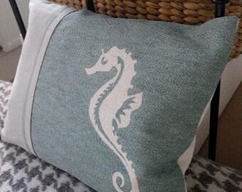 Pale, duck egg sea horse cushion.